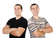 Two attractive positive smiling young men twins isolated Royalty Free Stock Photo