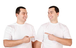 Two attractive positive smiling young men twins isolated Stock Photography