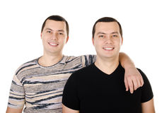 Two attractive positive smiling young men twins isolated Stock Images