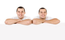 Two attractive positive smiling young men twins isolated Stock Image