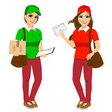 Two attractive post women in uniform Royalty Free Stock Images