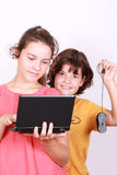 Two attractive sisters with computer Stock Photo