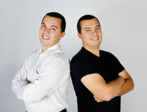 Two attractive smile young men twins Stock Photography