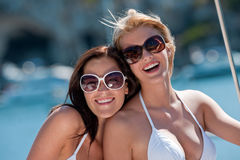 Two attractive smiling woman on sailboat royalty free stock images