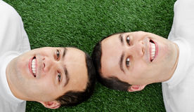 Two attractive smiling young men twins Royalty Free Stock Photography