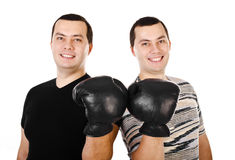 Two attractive smiling young men twins in boxing gloves isolated Stock Photo