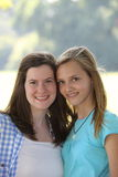 Two attractive smiling young teenage girls Stock Images