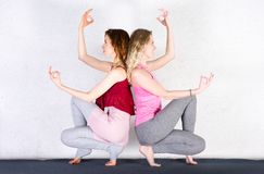 Two attractive sport girls work out nauka asana in fitness class royalty free stock images