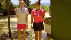 Two attractive stylish tennis players walking stock video