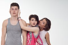 Two attractive teen girls and a boy have fun, Royalty Free Stock Photo