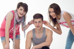 Two attractive teen girls and a boy have fun, Stock Photo