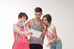 Two attractive teen girls and a boy have fun, Stock Images