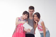 Two attractive teen girls and a boy have fun, Royalty Free Stock Images