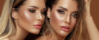 Two attractive twins women in glamour makeup. Beauty and femininity concept. Two attractive twins women in glamour makeup. Portrait photo stock photo