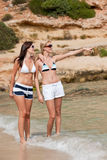 Two attractive woman in bikini on the beach Royalty Free Stock Photography