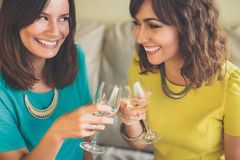 Two attractive woman toasting with champagne Stock Photos
