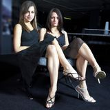 Two attractive women in black dresses Royalty Free Stock Photos