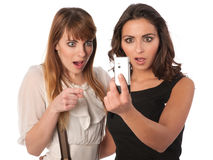Two attractive women checking message Stock Photography