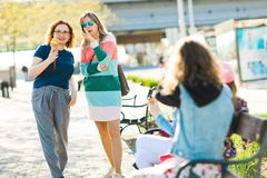Two women in the city walking together - chatting royalty free stock image