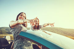 Two attractive women in a convertible Stock Photography