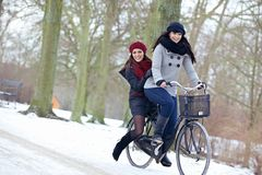 Two Attractive Women Enjoying the Cold Outdoors Royalty Free Stock Photography