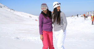 Two attractive women friends at a ski resort Stock Photos