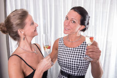 Two attractive women - getting ready for the evening.  Stock Photo