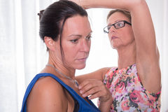 Two attractive women - getting ready for the evening.  Stock Photos