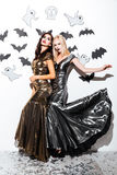 Two attractive women with gothic vampire makeup on helloween party stock image
