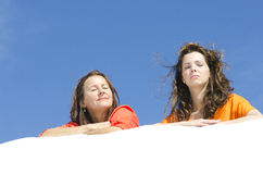 Two attractive women relaxed at beach Royalty Free Stock Image