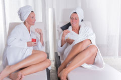 Two attractive women resting after the sauna Stock Image