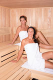Two attractive women in the sauna Stock Images