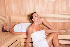 Two attractive women in the sauna Stock Photo
