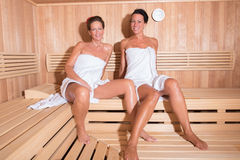 Two attractive women in the sauna Stock Photos
