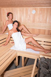Two attractive women in the sauna.  royalty free stock photos