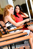 Two attractive women in street cafe Stock Photography