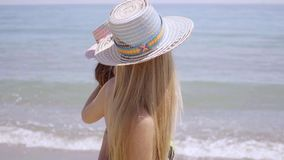Two attractive women in trendy sunhats stock footage