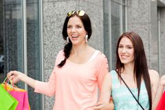 Two attractive young girls women on shopping tour Stock Photo