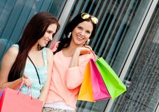 Two attractive young girls women on shopping tour Royalty Free Stock Images
