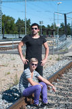 Two attractive young guys on rails Royalty Free Stock Photos