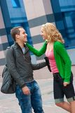 Two attractive young people met in the street Stock Images