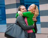 Two attractive young people met in the street. And they are happy Stock Image