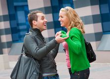 Two attractive young people met in the street. And they are happy Royalty Free Stock Photo