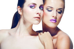 Two attractive young women with beautiful makeup. Stock Image