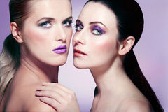 Two attractive young women with beautiful makeup. Stock Photography