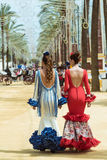 Two attractive young women in Feria dresses Royalty Free Stock Photos