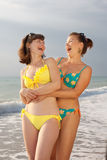 Two attractive young women at the sea Stock Images
