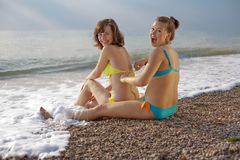 Two attractive young women at the sea Royalty Free Stock Images
