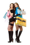 Two attractive young women after shopping Stock Photos