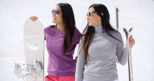 Two attractive young women with their snowboards Stock Photos